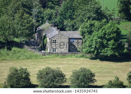 A cottage surrounded by trees #1435924745