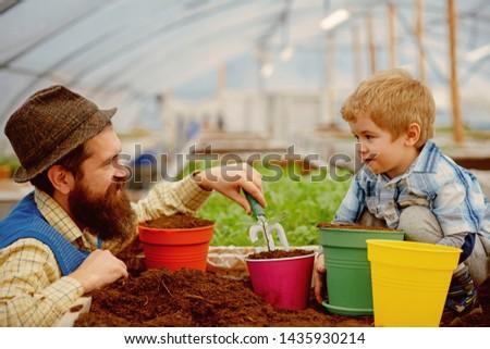 soil fertility concept. examine quality of soil fertility. good soil fertility in modern greenhouse. soil fertility industry. #1435930214