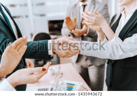 Close up of two business partners shaking hands. Colleagues clapping. #1435943672