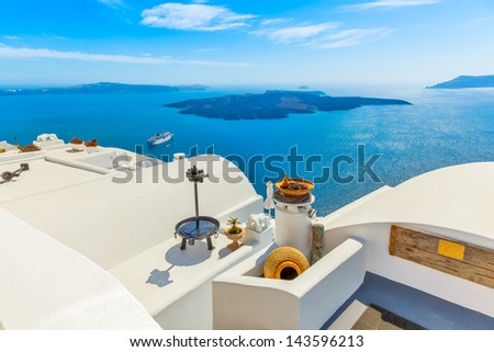 Greece Santorini island in Cyclades, traditional detail sights of colorful flowers with pots and caldera sea in background #143596213