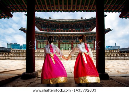 Focus at the old building, Korean lady in Hanbok or Korea gress and walk in an ancient town and Gyeongbokgung Palace in seoul, Seoul city, South Korea. #1435992803