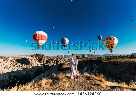 The couple meets the dawn. The man proposed to the girl. Family trip to Turkey. Couple at the balloon festival. Couple travels the world. Holidays abroad. The Landscapes Of Cappadocia #1436124560