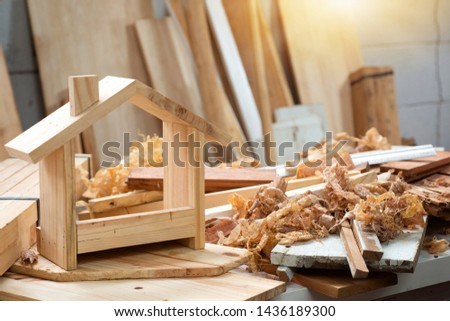 Finished handmade goods in workshop, diy wood work, wooden plank in background, concept of diy #1436189300