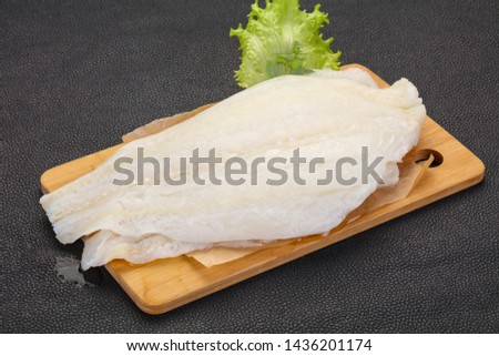 Raw halibut fillet ready for cooking