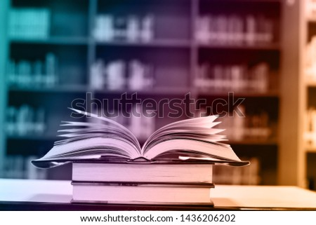 Abstract colorful of open book on wooden table and blurred background, education background. #1436206202