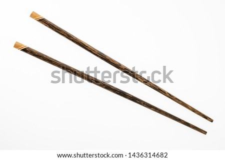 Wooden chopsticks isolated on white background #1436314682