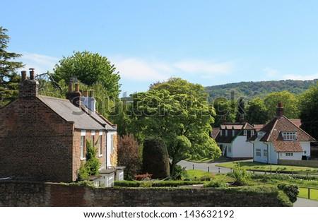 Scenic view of homes in quaint English village, summer scene. #143632192