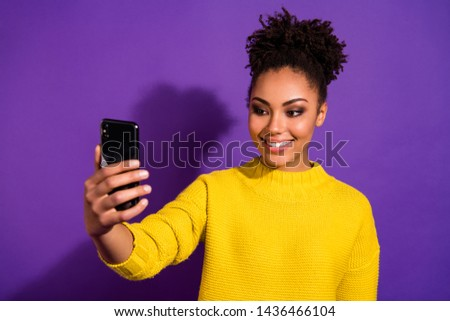 Close-up portrait of nice attractive lovely winsome sweet cheerful cheery wavy-haired girl holding in hands device taking making selfie isolated over bright vivid shine violet background #1436466104