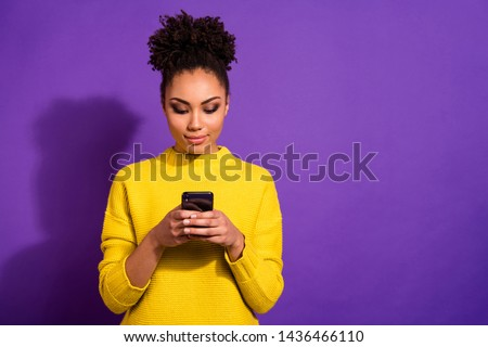 Portrait of her she nice attractive lovely winsome sweet gorgeous focused wavy-haired girl holding in hands device gadget isolated over bright vivid shine violet background #1436466110
