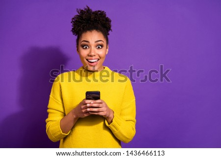 Portrait of her she nice attractive lovely cheerful cheery glad amazed wavy-haired girl holding in hands device notification news isolated over bright vivid shine violet background #1436466113