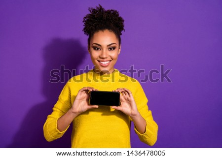 Portrait of her she nice attractive charming cheerful cheery content wavy-haired girl holding in hands device hobby smm post blog isolated over bright vivid shine violet background #1436478005