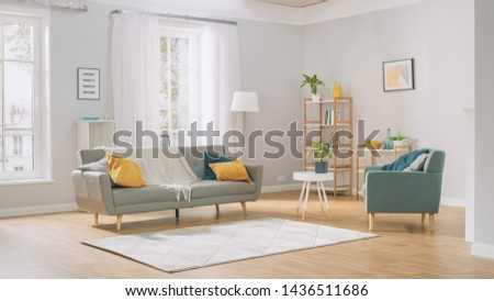 Shot of a Bright Cozy Modern Apartment with Big Windows, Decorations and Stylish Furniture.