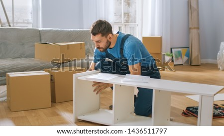Professional Furniture Assembly Worker Assembles Shelf. Professional Handyman Doing Assembly Job Well, Helping People who Move into New House. #1436511797