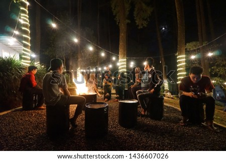 Pekalongan, Indonesia - June 21, 2019: The view of Kapeo Camp and the people. A camp near coffee shop in great view of Linggo Asri campground. #1436607026