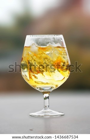 The glass of liqueur is beautiful with nature. #1436687534