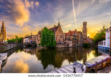 Classic view of the historic city center of Bruges (Brugge), West Flanders province, Belgium. Sunset cityscape of Bruges. Canals of Brugge #1436770457