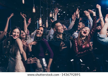 Portrait cute attractive lovely youth millennial person laugh excited funny funky motion having fun free time raise fists fromal wear suit dress fashionable modern magnificent indoors dance floor #1436792891