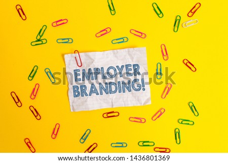 Text sign showing Employer Branding. Conceptual photo promoting company employer choice to desired target group Blank crushed paper sheet message clips binders plain colored background. #1436801369