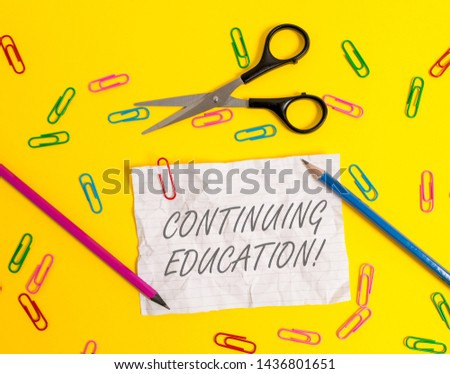 Writing note showing Continuing Education. Business photo showcasing Continued Learning Activity professionals engage in Crushed striped paper sheet scissors pencils clips colored background. #1436801651
