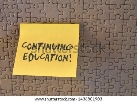 Writing note showing Continuing Education. Business photo showcasing Continued Learning Activity professionals engage in Square paper piece notation stick to textured glass window. #1436801903