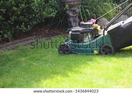 lawn mower mowing the lawn #1436844023
