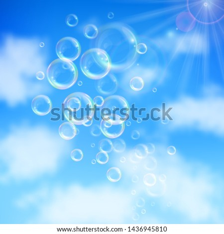 Realistic transparent floating soap bubbles on blue sky background. Design element for advertising booklet, flyer or poster #1436945810