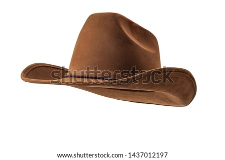 Rodeo horse rider, wild west culture, Americana and american country music concept theme with a brown leather cowboy hat isolated on white background with clip path cut out #1437012197