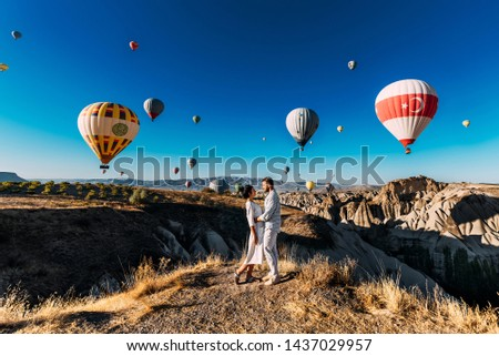 Lovers travel to Turkey. The man proposed to the girl. Family trip to Turkey. Couple at the balloon festival. Honeymoon trip. Couple travels the world. The Landscapes Of Cappadocia #1437029957