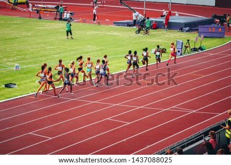 Female track and field race at athletics stadium. Professional female runners. Concept photo for olympic competition in tokyo 2020 #1437088025