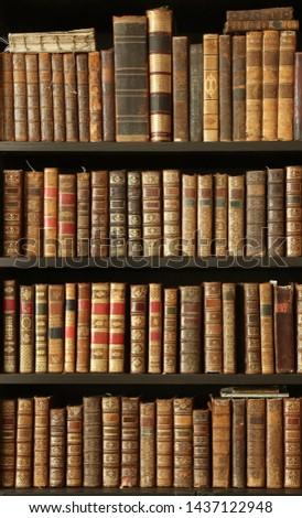 old books on wooden shelf #1437122948
