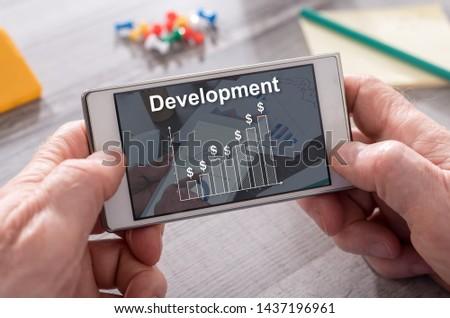 Development concept on mobile phone #1437196961