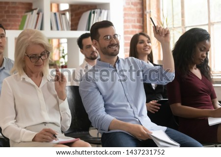 Training audience participants raise hands up ask question at conference workshop meeting sit on chairs, business people group voting participate corporate lecture conference seminar presentation #1437231752