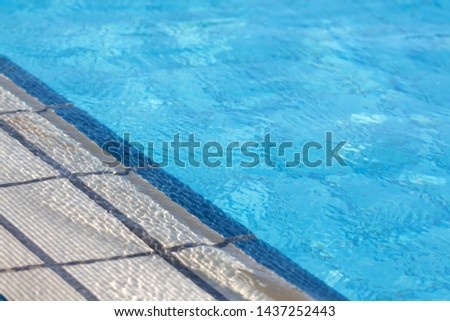 Side of the Pool with Water #1437252443