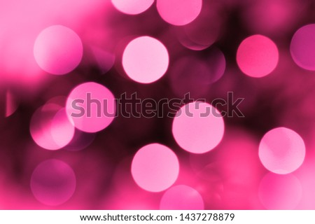 Blurry garland with lights. Plastic pink toning. Christmas coming concept. Abstract neon pinkl art background.