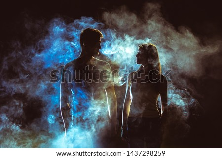 The silhouette of couple in the smoke #1437298259