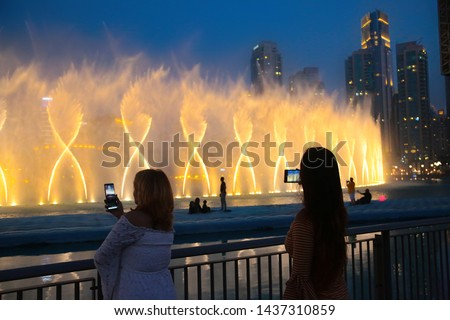 Dubai reopens after ease the lockdown restrictions due to covid-19, restart tourism, Dubai Dancing Fountain Show, Tourist Taking Pictures, Magical view at night life, Luxury travel inspiration