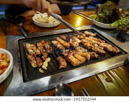 Samgyeopsal, grilled pork belly popular in South Korea. Three layer flesh referring to striations of lean meat and fat in the pork belly. Favorite Korean food. K-food. Korean barbecue. Korean BBQ. #1437352544