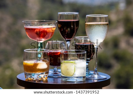 Alcoholic beverages. Different types of alcoholic beverages poured into different types of glasses. #1437391952