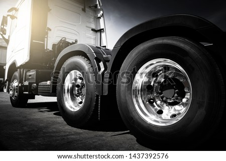 Semi truck trailer freight industry transport, Closeup a truck wheels of modern truck . #1437392576