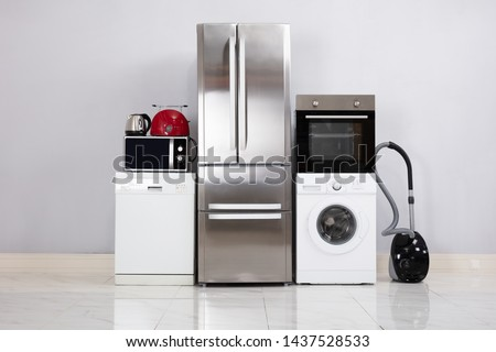 Close-up Of Home Electronic Appliances On Floor Against Grey Wall In New House #1437528533