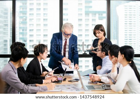 Successful Business team Meeting at meeting room in office, businessman  owner holding papers coworkers making great business discussion ,Teamwork business training success concept #1437548924