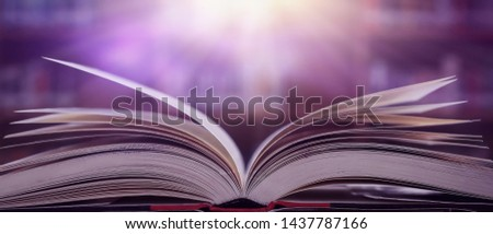Imagine a picture book of an ancient book opened on a wooden table with a sparkling golden background. With magical power, magic, lightning around a glowing glowing book In the room of darkness #1437787166