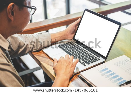 Senior professional businessman in casual wear working using laptop in cafe with business working connecting to wireless via computer, blank screen. #1437865181