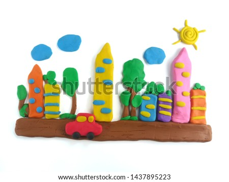 Colorful plasticine clay created to be the red car runs on the city streets with tall buildings, shady trees, in the sky with the sun and clouds on white background, beautiful town are dough