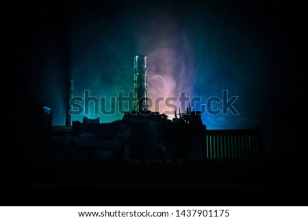 Creative artwork decoration. Chernobyl nuclear power plant at night. Layout of abandoned Chernobyl station after nuclear reactor explosion. Selective focus #1437901175