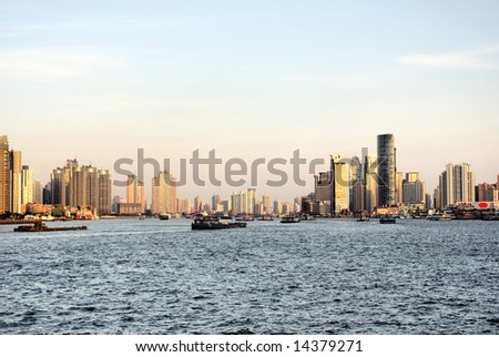 China Shanghai  Pudong sunset on the Huangpu river, riverfront buildings #14379271