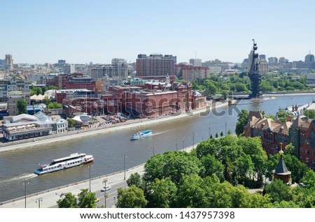 "Moscow, Russia - June 4, 2019: Summer view of the Bersenevskaya embankment, the building of the former confectionery factory ""Red October"" and the monument to Peter the Great #1437957398"