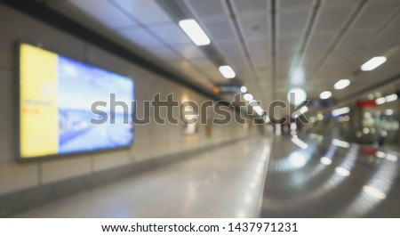 Blur photo of hand rail, walk way and background in subway. Daily life in public transportation. Copy space for text  and editing. Blur background photo concept. Defocus photo.