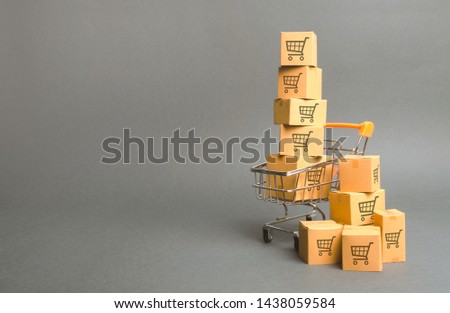 Shopping cart and boxes with drawing of smaller carts. goods sale. commerce, online shopping. Purchasing power, delivery order. E-commerce, sales and sale of goods through online trading platforms. #1438059584