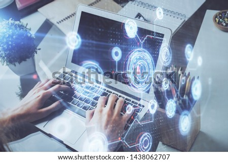 Multi exposure of technology hologram with man working on computer background. Concept of big data. #1438062707